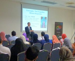 Bill Frost - Hypnotherapy, NLP and EMDR Lecturer & Therapist teaching an group of medical students