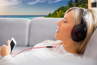 Relaxed woman listening to hypnosis download